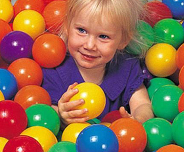 a girl playing on a indoor jumpy house