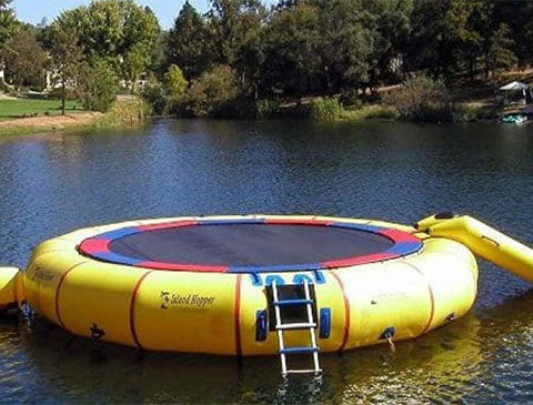 yellow water trampoline setted up in a park