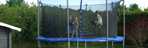 kids on a large trampoline
