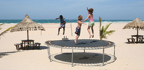 kids jumping on a medium size trampoline