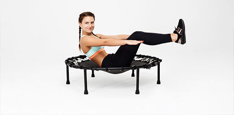 women exercising on a small trampoline