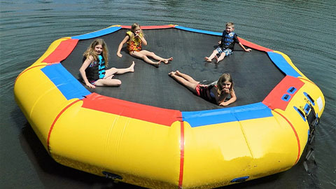 girls on water trampoline