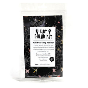 Kate Burlech's Art Color Kit front view. Clear bag with dark floral print behind white label with black A.C.K. Logo's elongated letters in Gandy style. Shows that product is handmade in Denver, Colorado and contains Color sheet, Crayons, & vinyl sticker