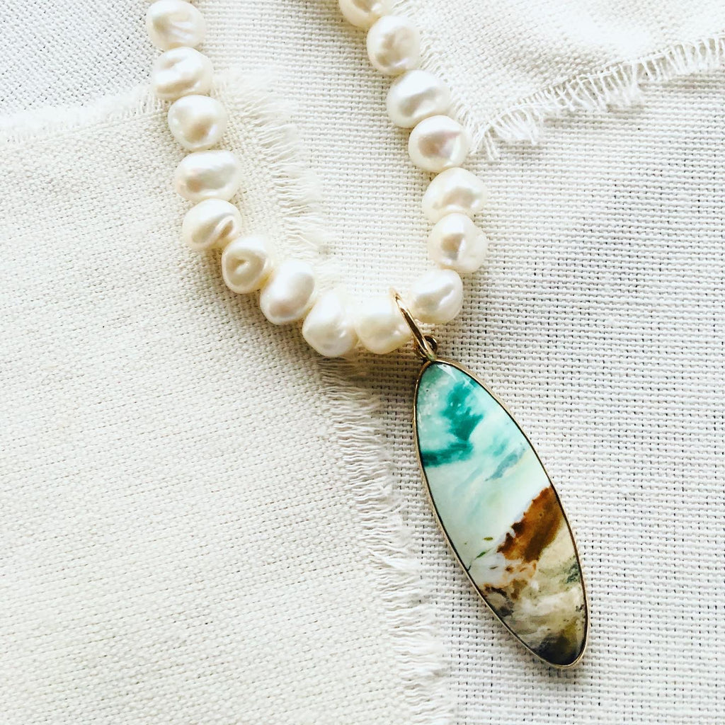 This stunning blue opalized fossilized Indonesian wood necklace reminds me of the ocean and beaches of Hawaii.  Blue opalized wood has recently been discovered and makes for gorgeous one of a kind resort jewelry.
