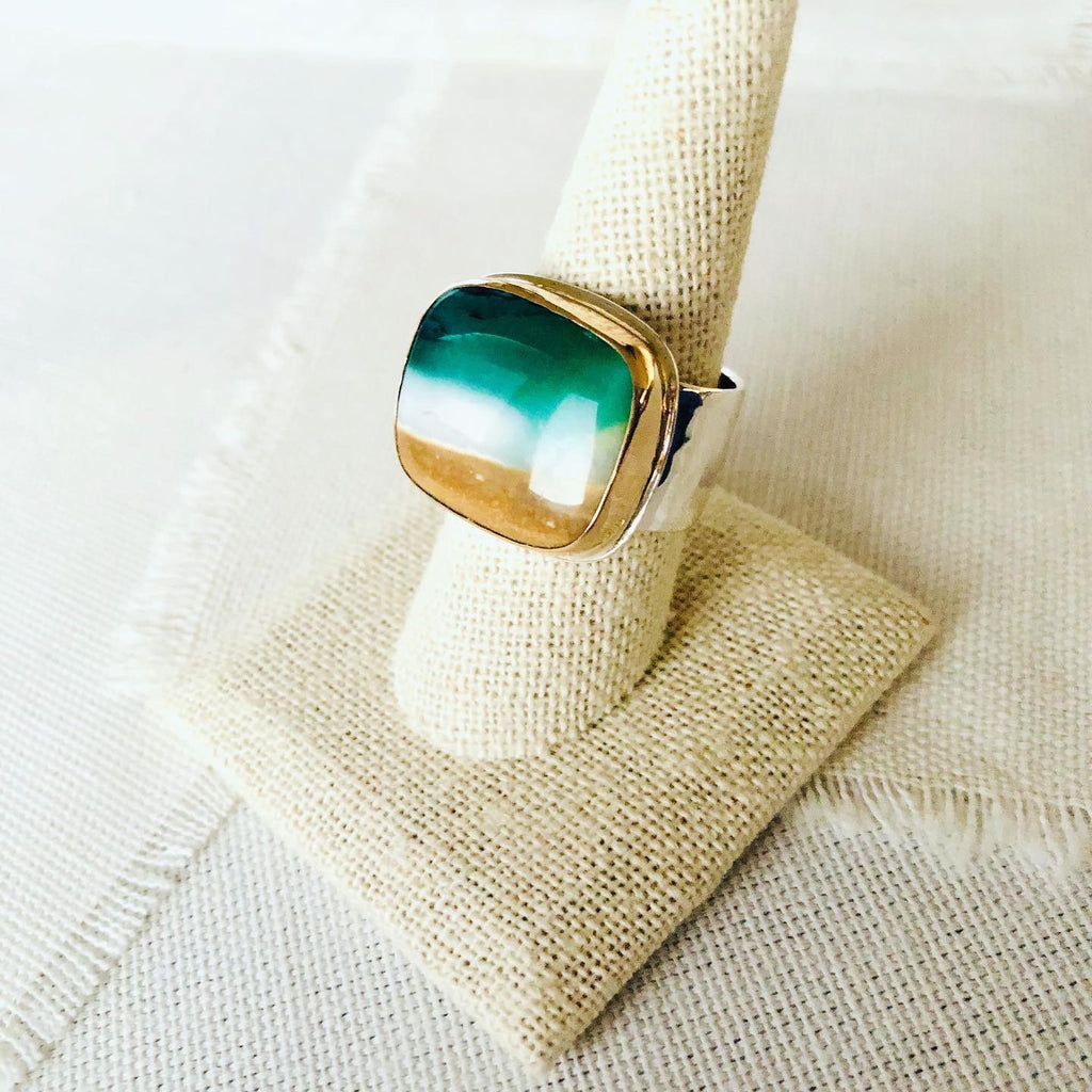 This incredible ring is made from blue opalized fossilized Indonesian wood and reminds me of the beaches of Mauil