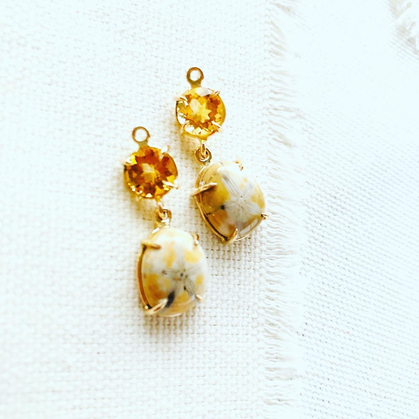 Sea urchin earrings paired with citrine and set in 14kt gold.  These fossilized sea urchin earrings make a beautiful long lasting souvenir from Hawaii.