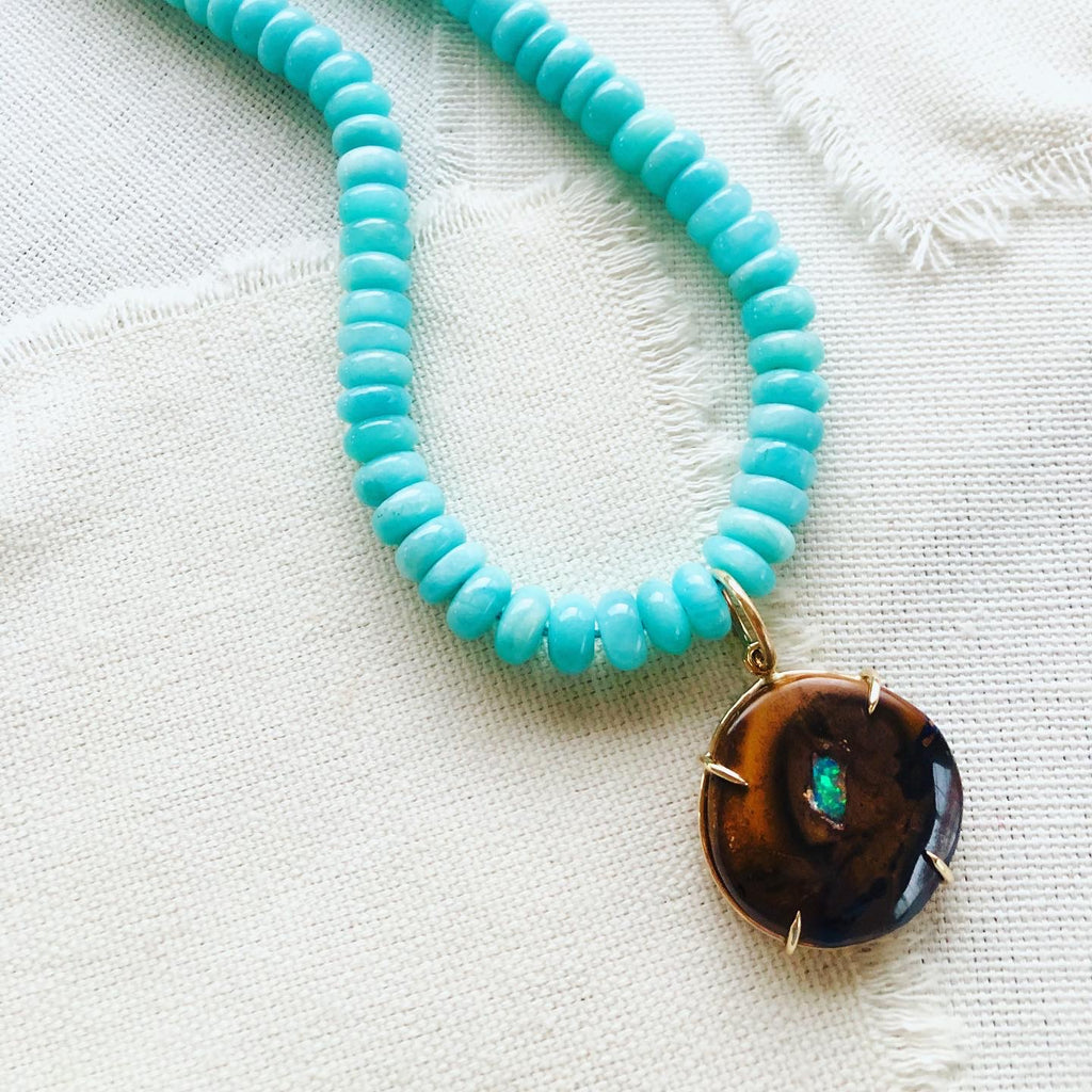 This gorgeous gold necklace is made from Yowah Nut and comes from Australian.  The Yowah Nut pendant is strung on a beautiful strand of turquoise colored Amazonite beads and finished with a 14kt gold clasp.