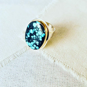 Let this turquoise statement ring compliment your resort lifestyle. The turquoise comes from Hubei and is bezel set in 14kt gold with sterling silver backplate and hand hammered shank.