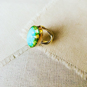 This ring is made with Sonoran Gold Turquoise and set in 14kt gold bezel with a handmade twisted shank. This turquoise statement ring reminds me so much of an ocean lagoon with surrounding rainforest like we have in Hawaii.