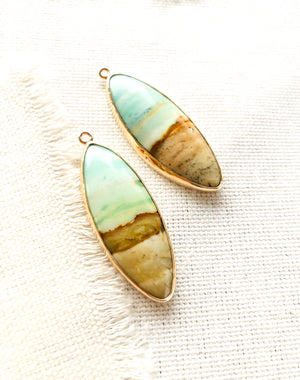 A little bit of ocean and beach? These blue opalized fossilized Indonesian wood earrings remind me so much of the beaches in Maui.