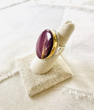 This is a beautiful elegant resort style spiny oyster shell statement ring set with a 14kt gold bezel and sterling silver  Edit alt text