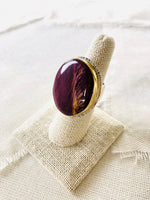 This is a beautiful elegant resort style spiny oyster shell statement ring set with a  14kt gold bezel and sterling silver