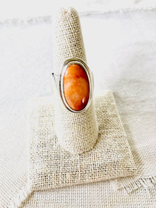 This simplicity of this beautiful orange spiny oyster shell ring makes a statement for itself.