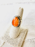 Beautiful orange spiny oyster shell ring set in 14kt gold and sterling silver for your resort beach getaway.