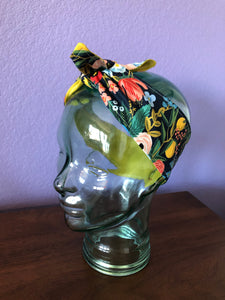 Floral Rifle Paper Co. fabric headband placed on a glass display head
