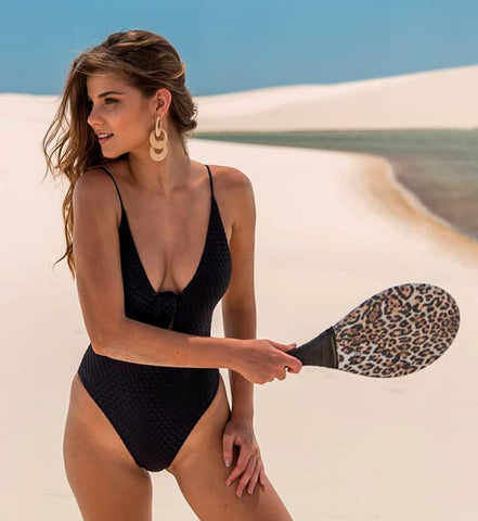 This bikini suit can connect the upper body and lower body, although it may expose the breast or hips or both or be less covered.