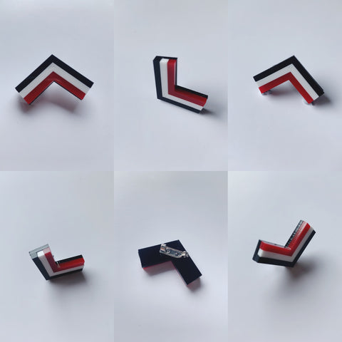 MISS MAIA | Tainui Pin | Red, Black and White. This pin is a representation of the Tainui leaf and their distinctive raised veins. These pins look great on collars, lapels and breast pockets.