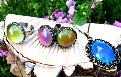 colorful mood rings and a mood pendant in the garden