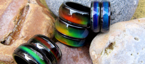 magnetic mood rings lying on a rock taken on the beach