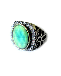 antique style mood ring showing green stone