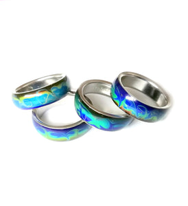 colorful swirly band mood rings with marble patterns in stainless steel