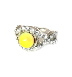 silver mood ring with pretty stones and a yellow mood color