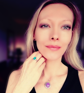 a beautiful blonde model wearing a sterling silver mood ring and a sterling silver mood pendant locket by best mood rings