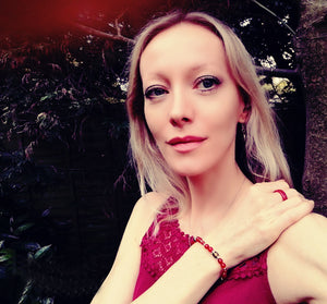 blonde model wearing a red agate mood ring and bracelet