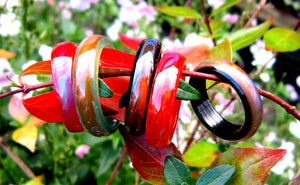 black, red, green agate mood rings in the garden