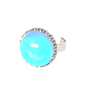 a circular mood ring in blue color with an adjustable band
