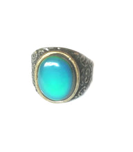 Load image into Gallery viewer, a bronze mood ring turning green blue color