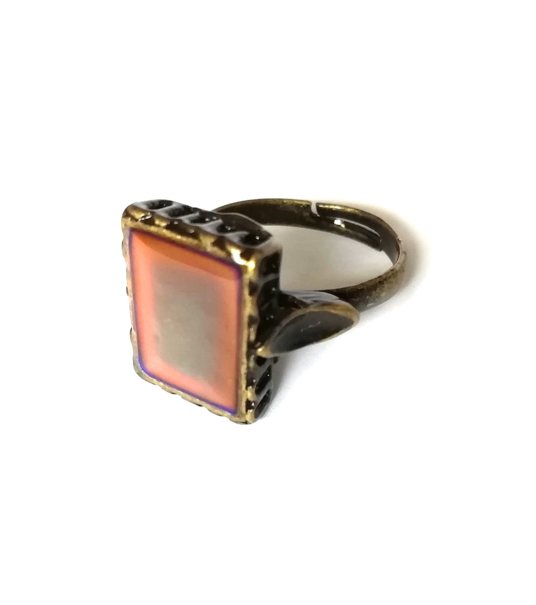 a bronze mood ring with a square mood and adjustable band