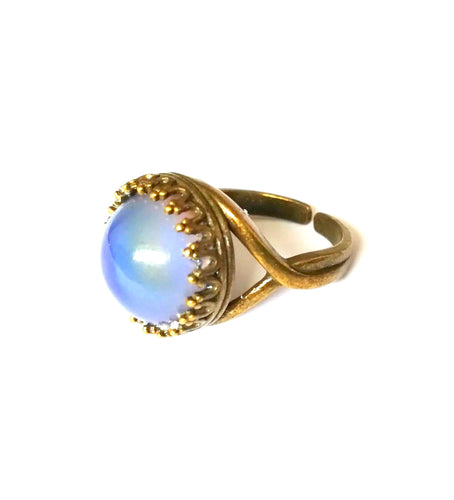 a bronzed crown setting mood ring with adjustable band