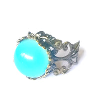 Load image into Gallery viewer, bronze mood ring with adjustable band showing a blue green mood meaning color
