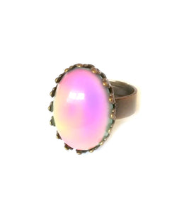 a bronze mood ring with crown setting showing a pink color mood meaning