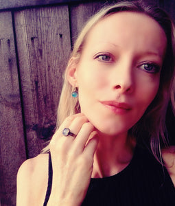 model wearing a mood ring in bronze color by best mood rings