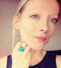 Load image into Gallery viewer, model wearing mood earrings and a bronze mood ring by best mood rings