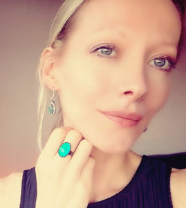 model wearing mood earrings and a bronze mood ring by best mood rings