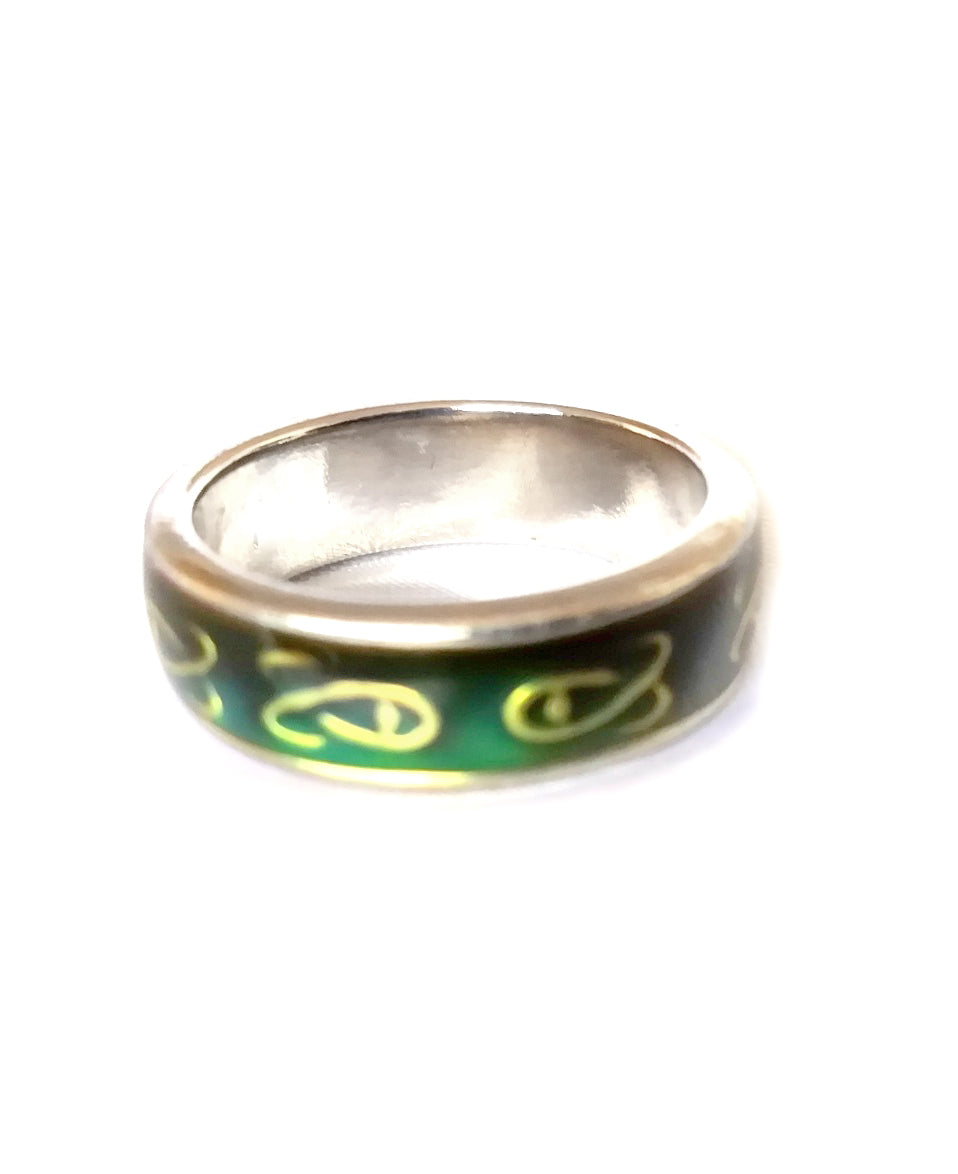a Celtic band mood ring with a Celtic knot