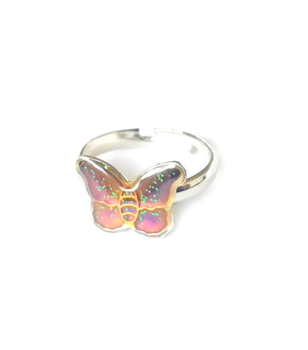 a child sized butterfly mood ring with a pink mood color