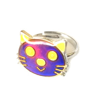 Load image into Gallery viewer, a cat face mood ring that also glows in the dark