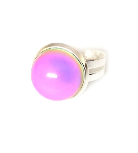 a child mood ring showing a pink color mood meaning in a circular design with adjustable band