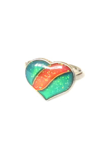 a child mood ring with heart and glitter inside