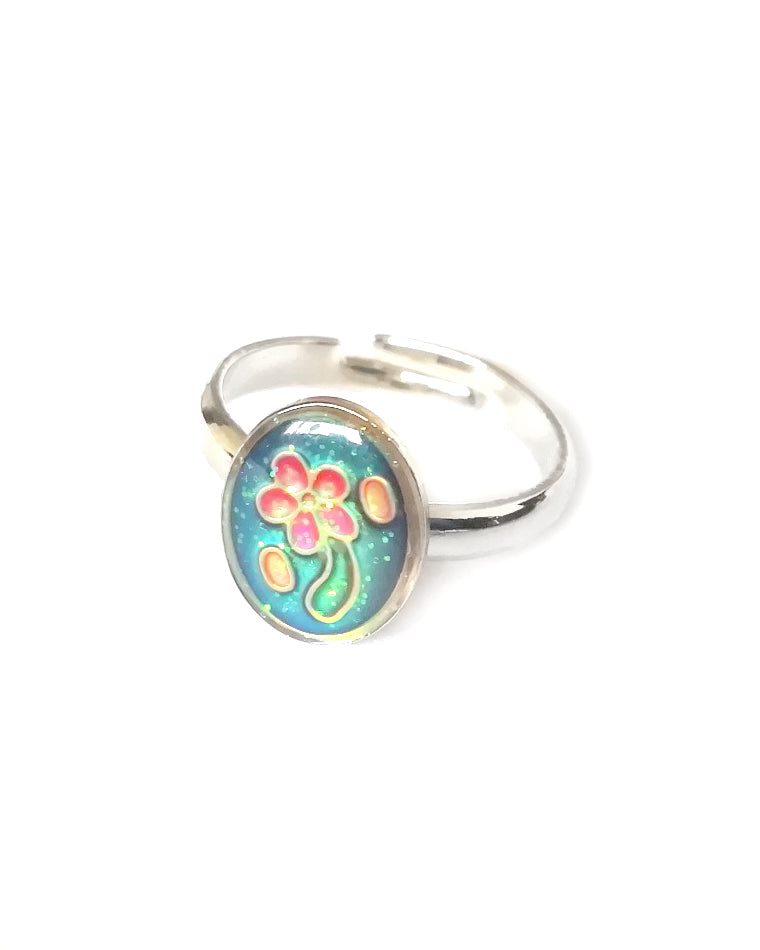 a child sized oval mood ring with flower inside