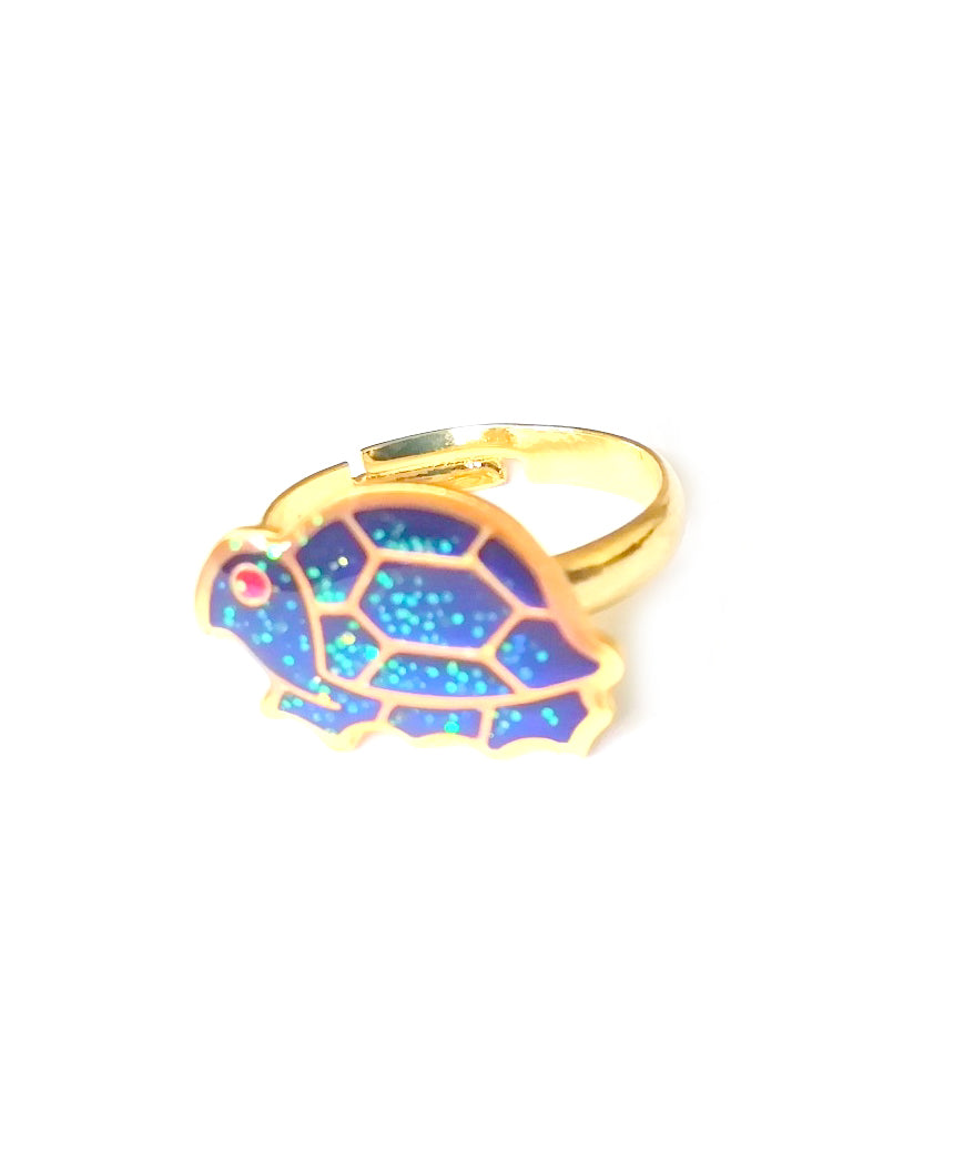 a gold colored child mood ring with a turtle shape