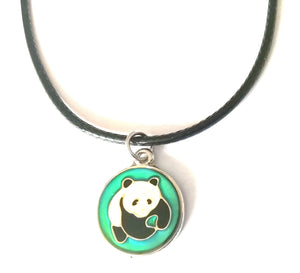 a circular mood pendant necklace with a panda design