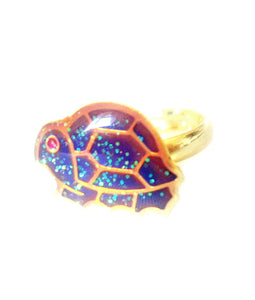 a turtle mood ring in a golden color for children