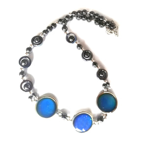 magnetic hematite mood necklace with circular moods showing a blue color meaning