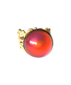 circular mood ring with a red mood and a gold shade band