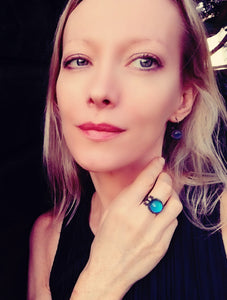 model wearing circular brass mood ring in a bronze shade by best mood rings